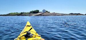 Kayaks approach Wood Island